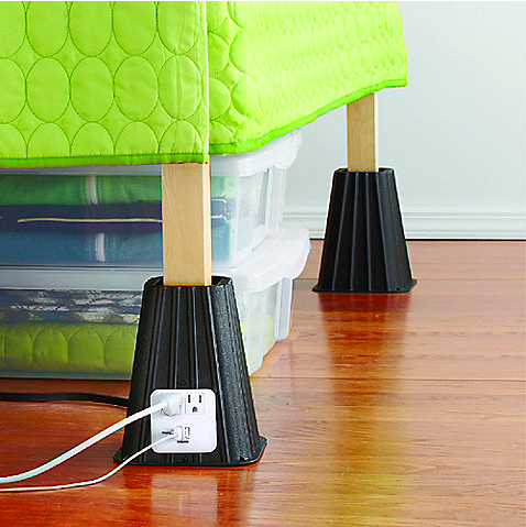 Bed risers with power outlet