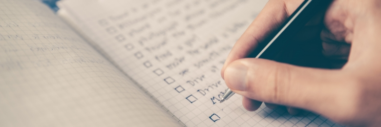 A person marking off items in a checklist
