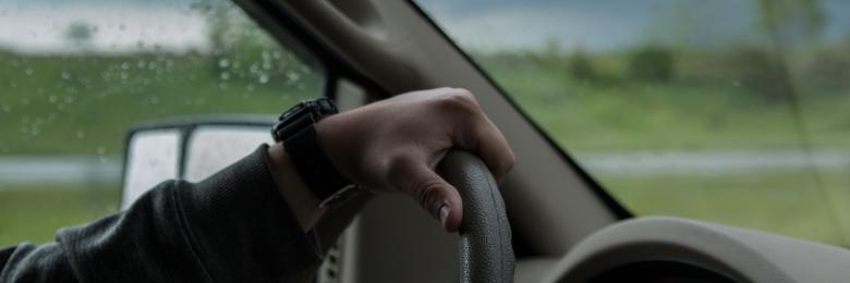 A person driving their car