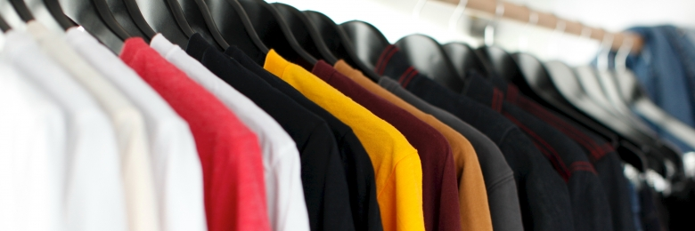Shirts hanging neatly in a closet
