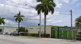The exterior of the Storage Post Lauderdale Manor self-storage facility