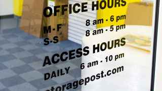 Photo of door at Storage Post self-storage, indicating daily access hours