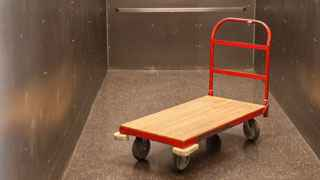 A red Storage Post hand cart