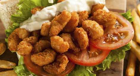 A po boy sandwich with toppings
