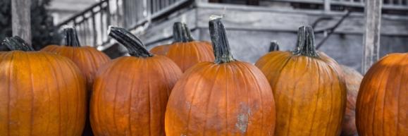 Pumpkins sitting on a porch