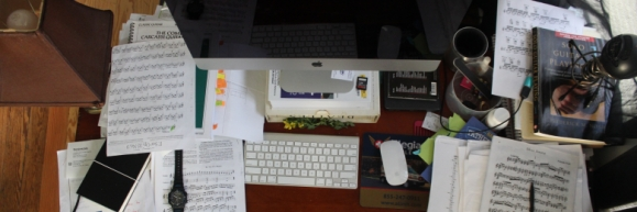 A cluttered desk with a computer