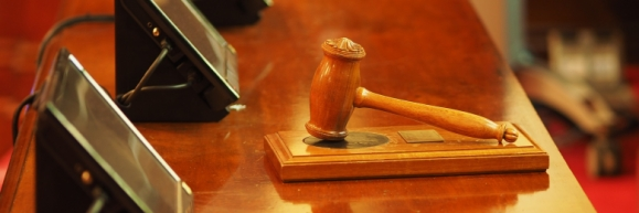 An auctioneer's gavel sitting on a table