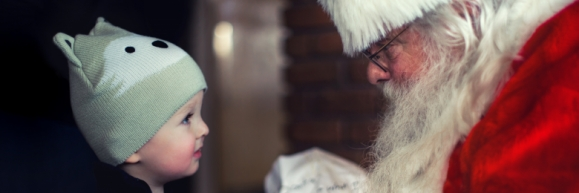 Santa talking to a little boy