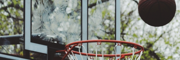 A basketball bouncing off the rim