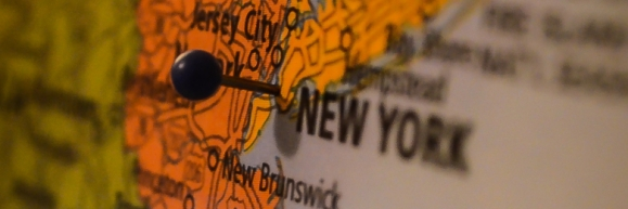 A pin stuck in a map of New York