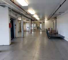 A well-lit hallway inside of the Chelsea Mini Storage facility